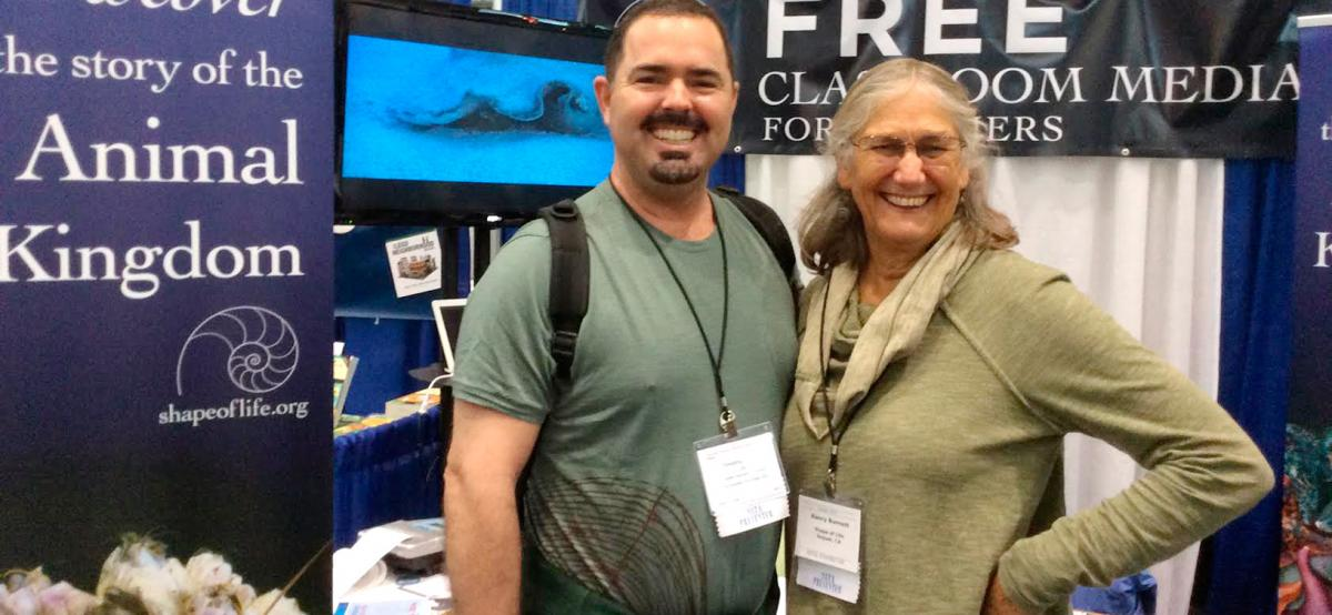 Photo of SoL founder Nancy Burnett with teacher Tim Griffin at NSTA Boston conference